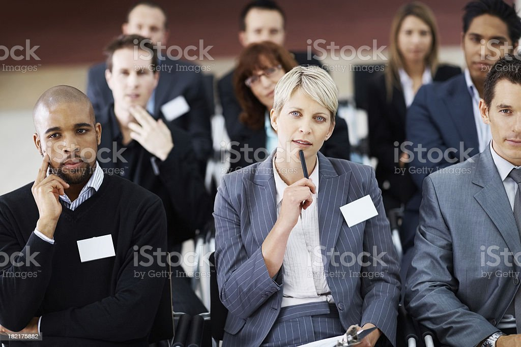Group of business associates sitting attentively at seminar royalty-free stock photo