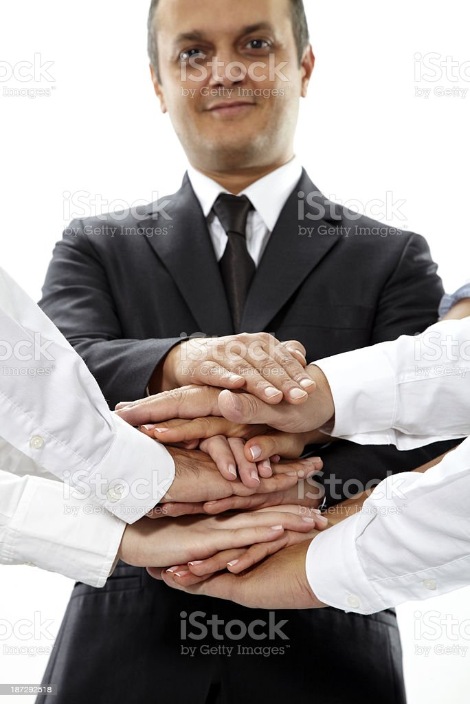 Group Of Business Colleagues Stacking Their Hand royalty-free stock photo
