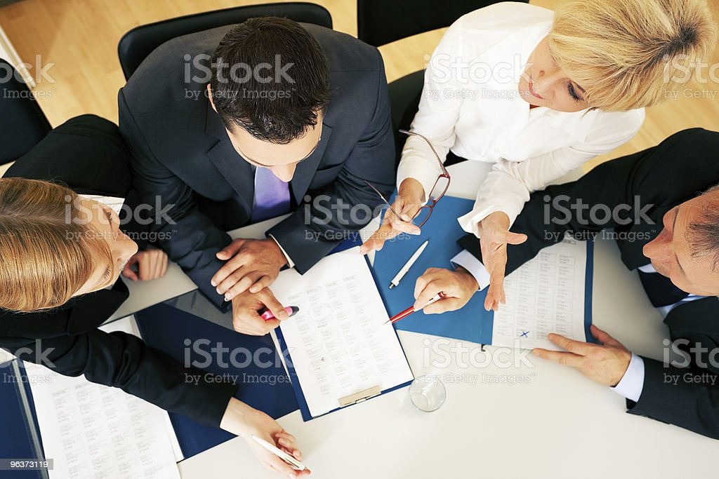 Group of business employees discussing business affairs stock photo
