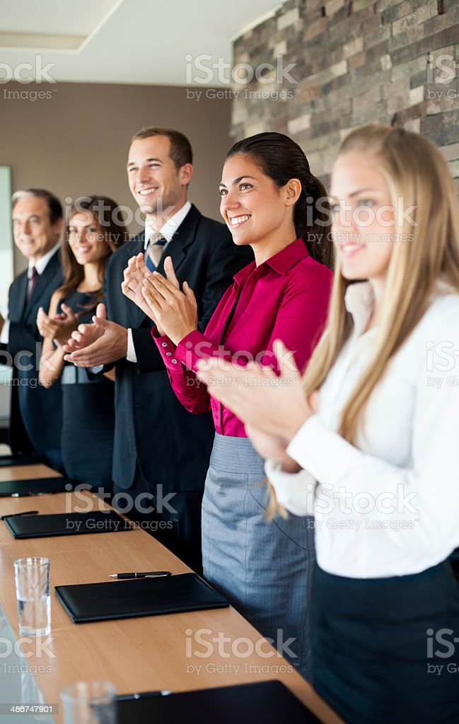 Group of business executives applauding forward royalty-free stock photo