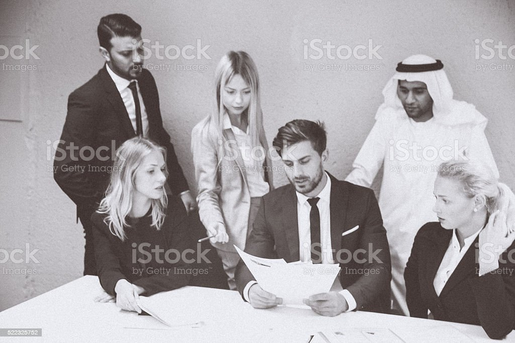 Group of Business Executives Concerned Over Monthly Reports stock photo