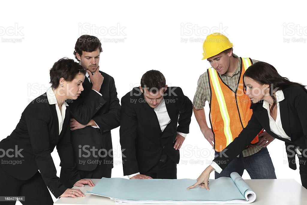 Group of business executives discussing a blueprint with an architect royalty-free stock photo