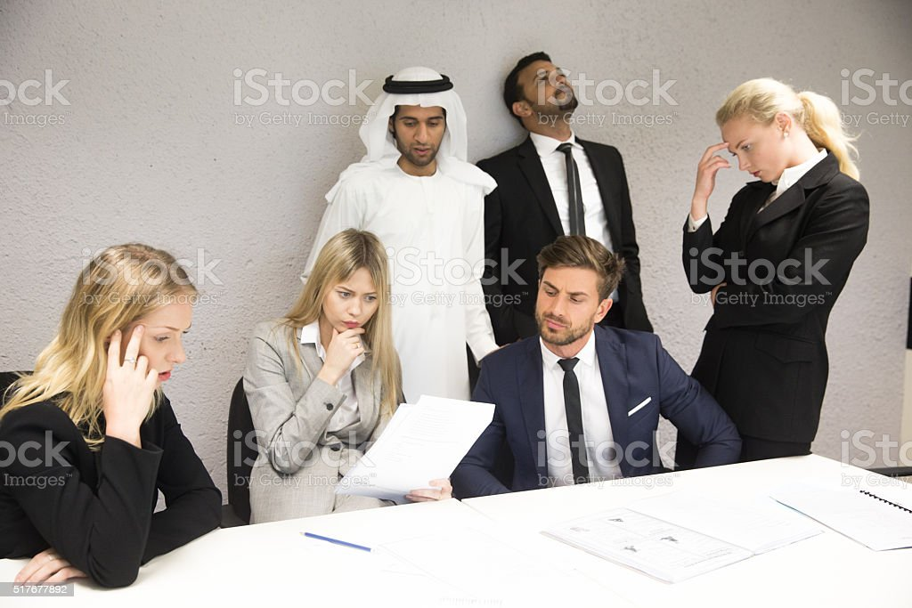 Group of Business Executives Frustrated Over Reports stock photo