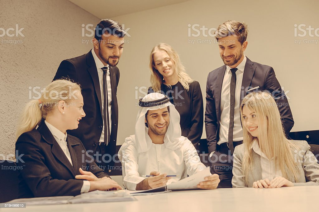 Group of Business Executives Happy With Business Reports. stock photo
