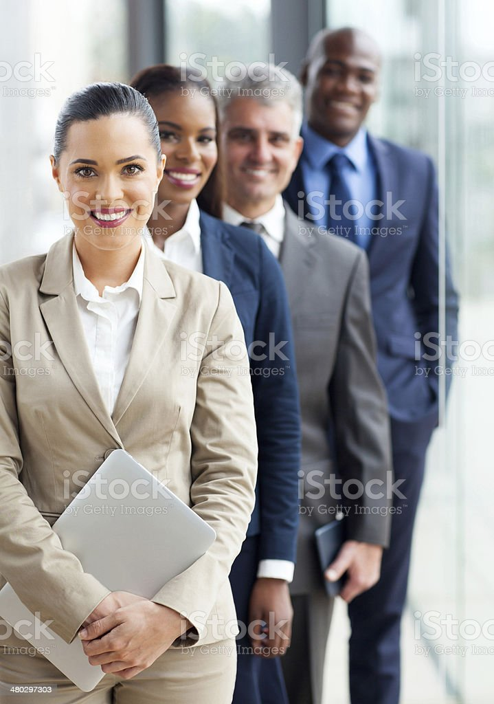 group of business executives standing in a row stock photo