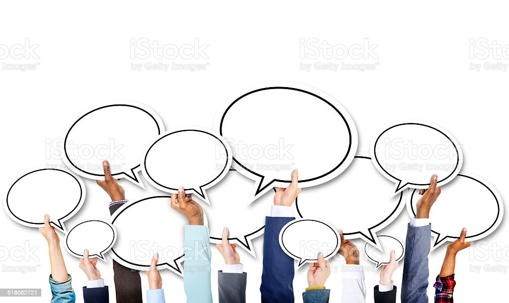 Group of Business Hands Holding Speech Bubbles stock photo