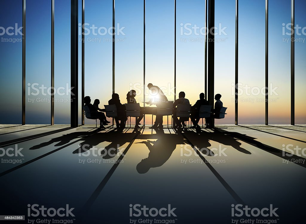 Group of Business Having a Meeting during Sunset stock photo