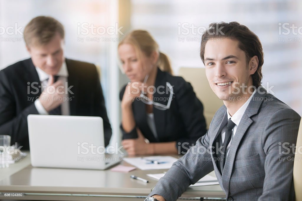 Group of business people and a young man stock photo