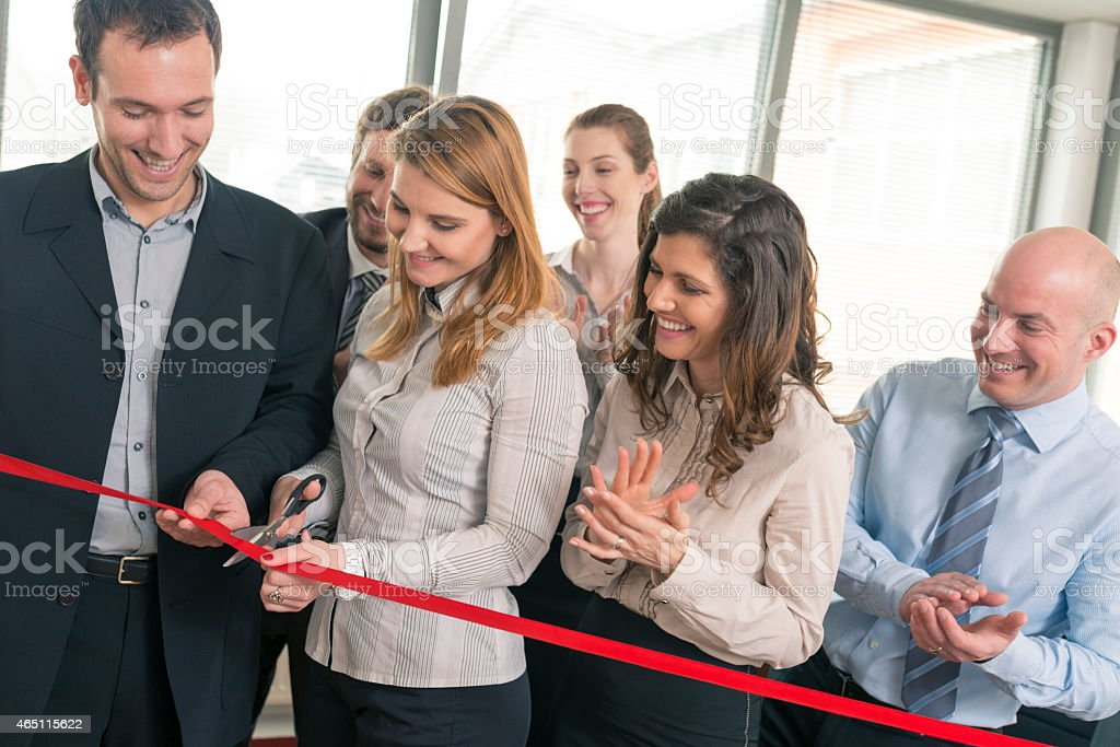 A group of business people at an ribbon cutting ceremony stock photo