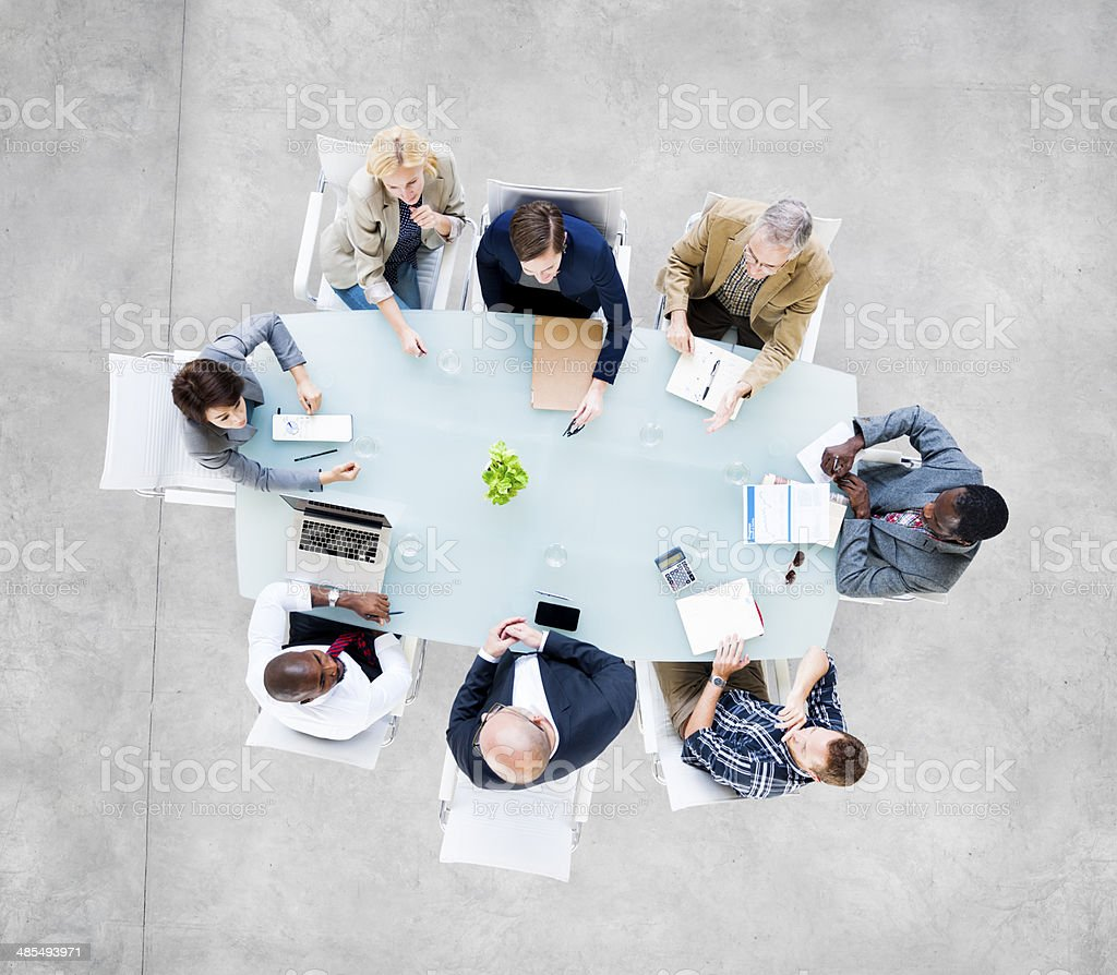 Group Of  Business People at Meeting Table stock photo