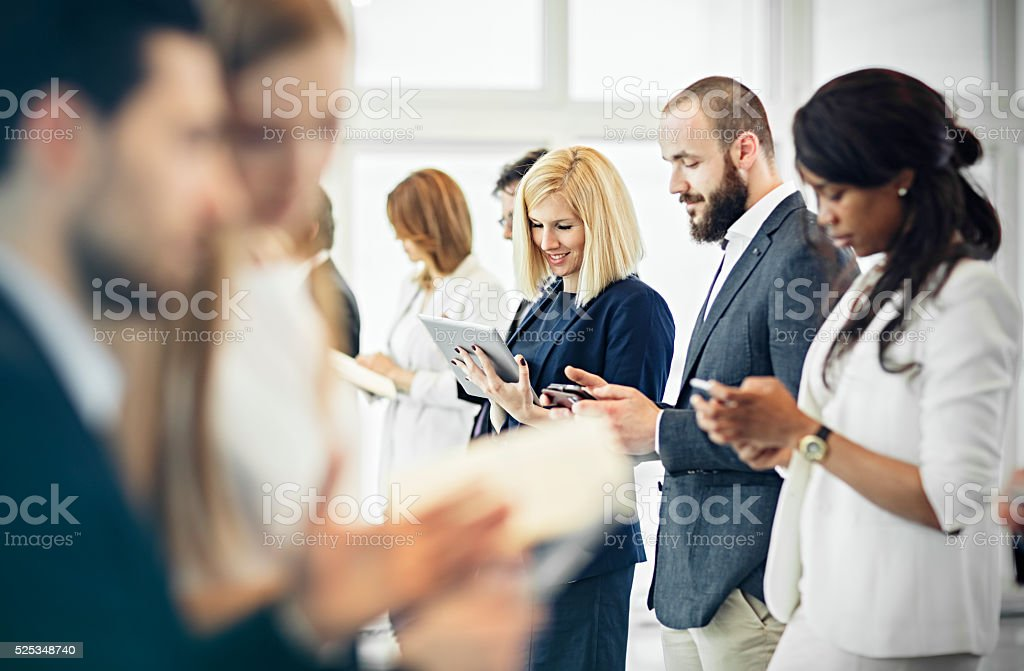 Group of business people at the office communicate stock photo