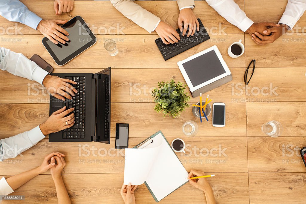 Group of business people at the office table stock photo