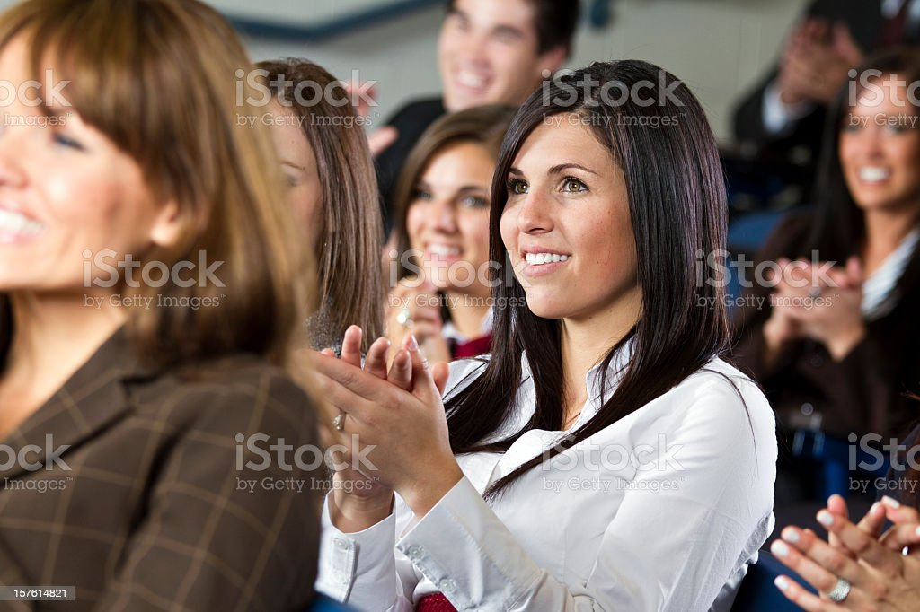 Group of business people clapping in a meeting royalty-free stock photo