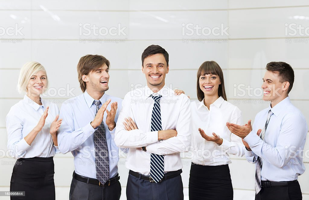 group of business people congratulating leader royalty-free stock photo