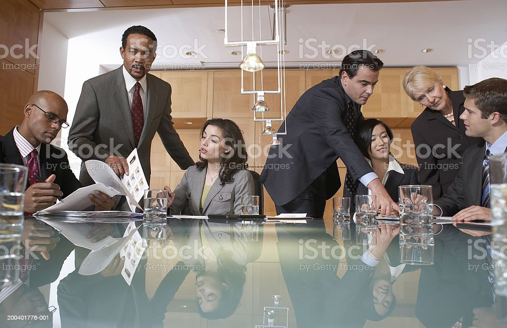 Group of business people conversing in conference room, view across table royalty-free stock photo