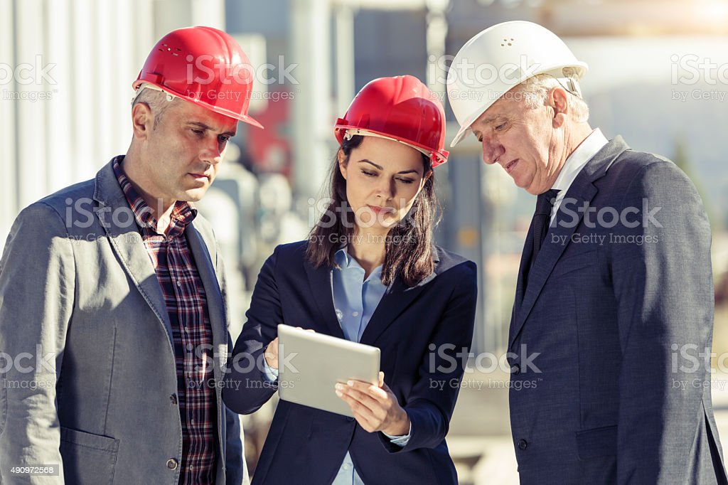 Group of business people discussing about the project outdoors stock photo