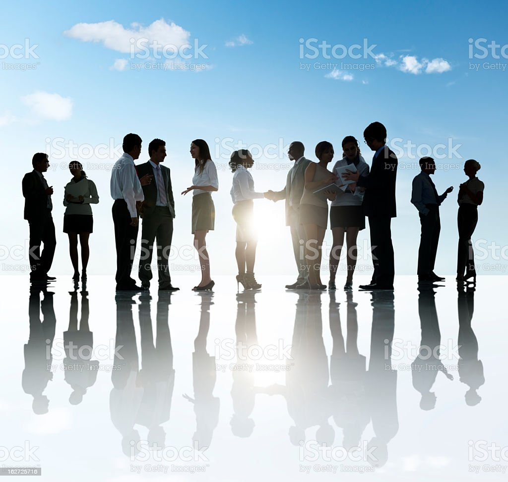 Group of business people discussing among themselves royalty-free stock photo