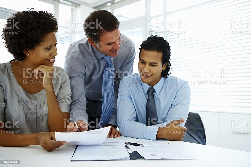 Group of business people discussing with documents royalty-free stock photo