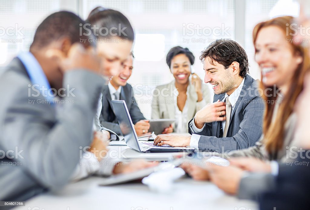 group of business people discussing work stock photo