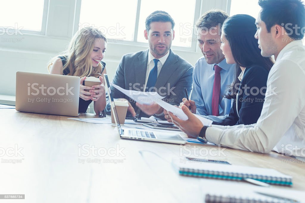 Group of business people having a meeting. stock photo