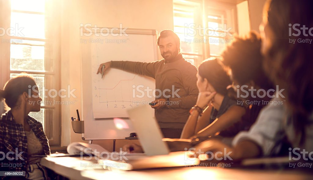 Group of business people having a presentation in the office. stock photo