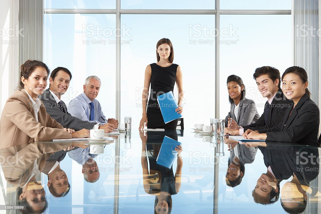 Group Of Business People Having Board Meeting Around Glass Table royalty-free stock photo
