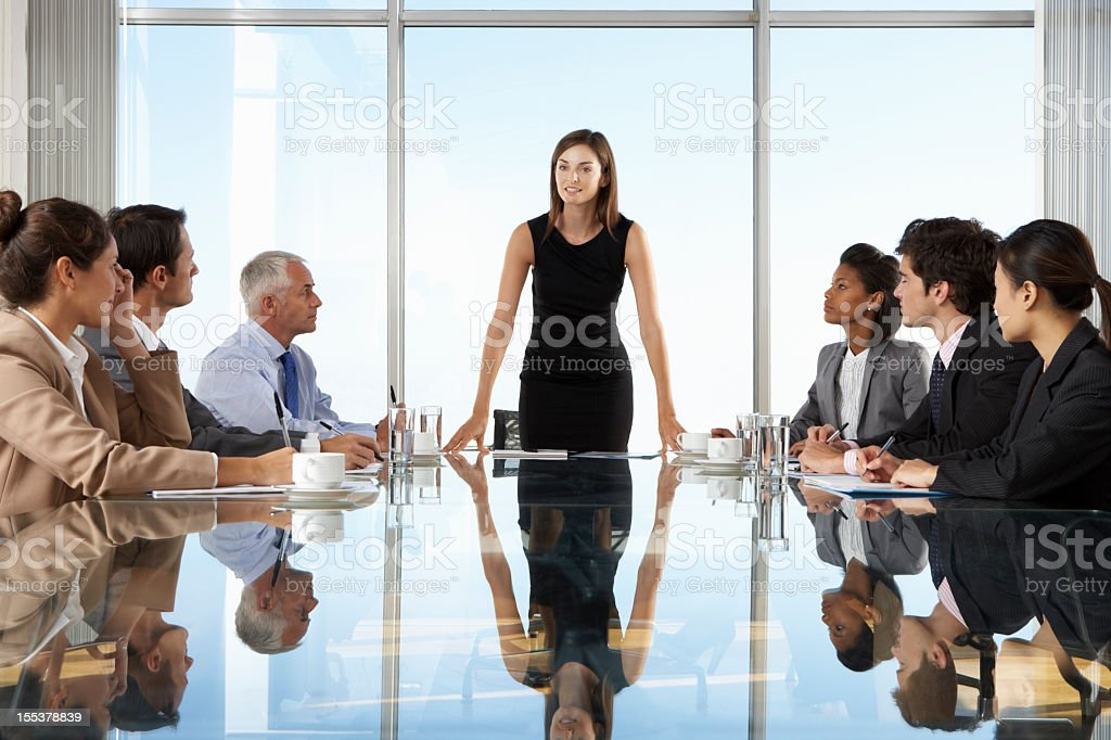 Group Of Business People Having Board Meeting stock photo