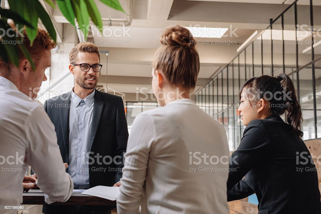 Group of business people having meeting together stock photo