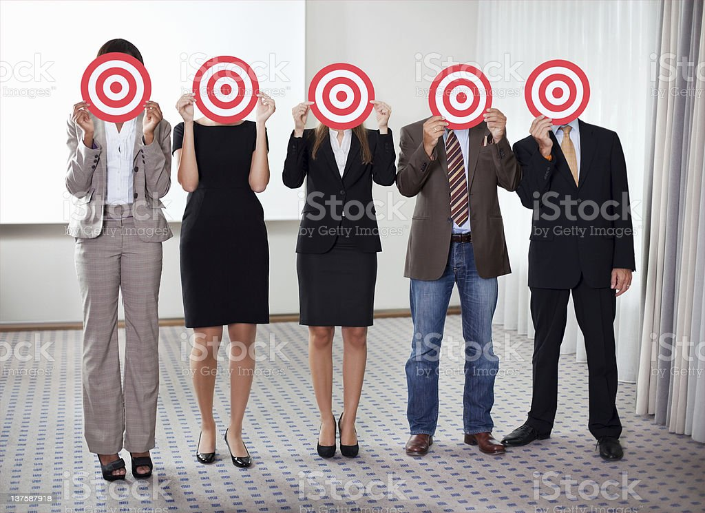 Group of business people holding a target stock photo