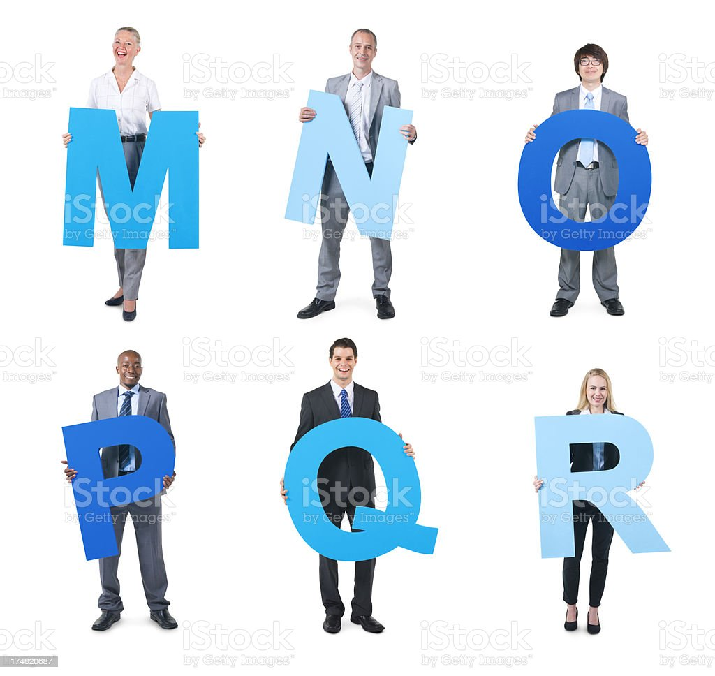 Group of business people holding the alphabet royalty-free stock photo