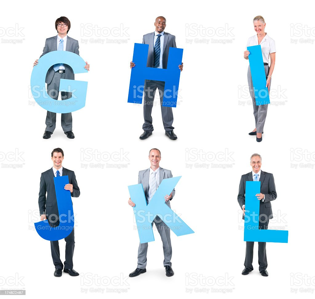 Group of business people holding the letter royalty-free stock photo
