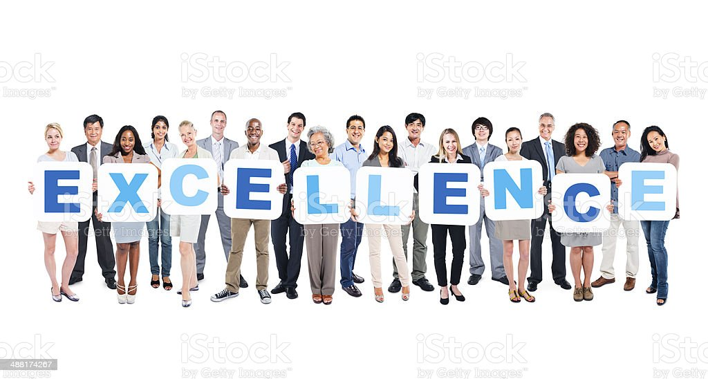 Group Of Business People Holding The Word Excellence stock photo