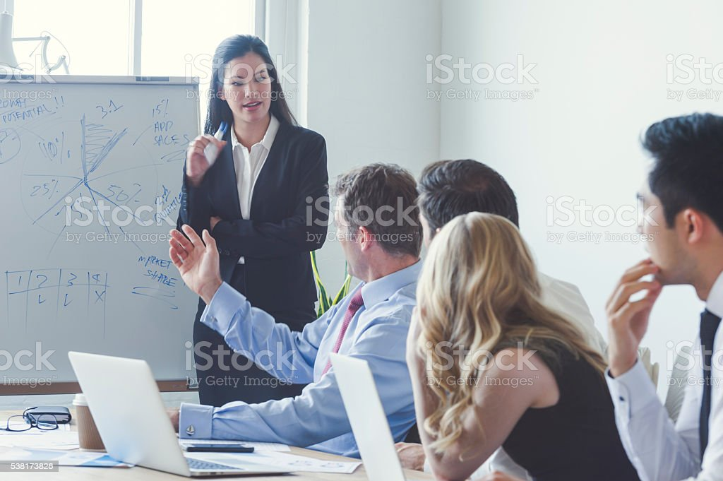 Group of business people in a boardroom presentation. stock photo