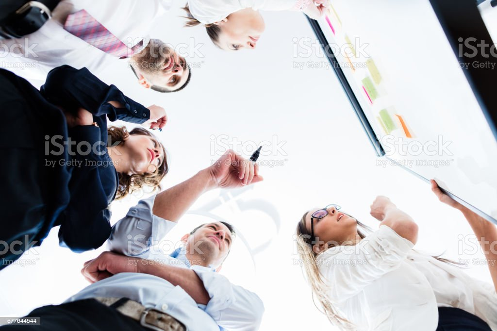 Group of business people in office at creative brainstorming stock photo