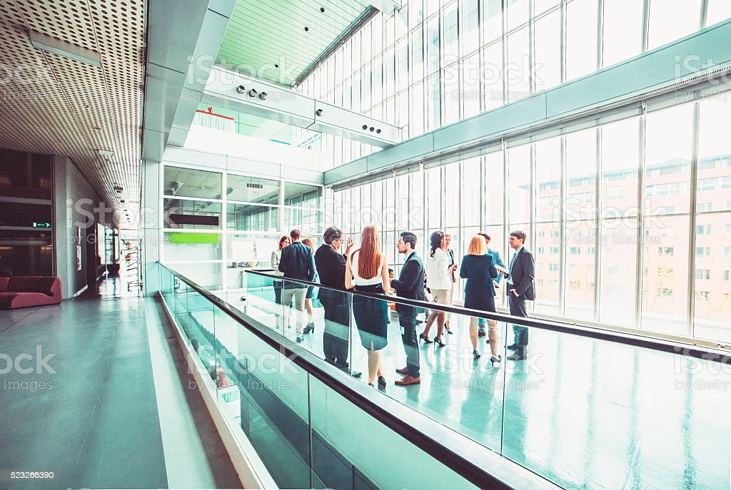 Group of business people in the office building lobby stock photo