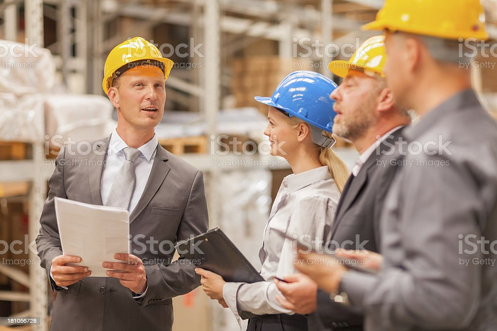 Group of business people in warehouse royalty-free stock photo