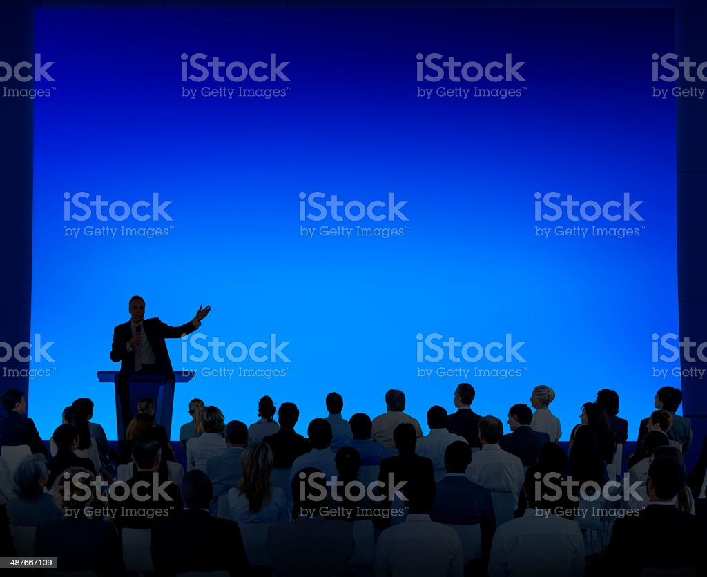 Group Of Business People Listening To A Speech stock photo