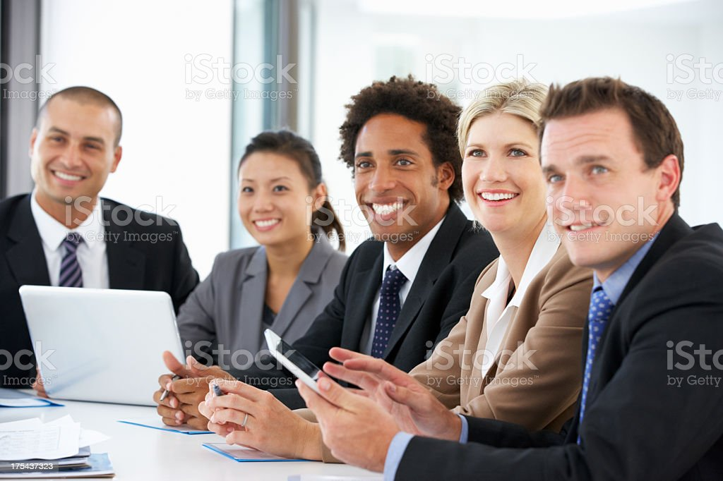 Group Of Business People Listening To Colleague Addressing Offic royalty-free stock photo