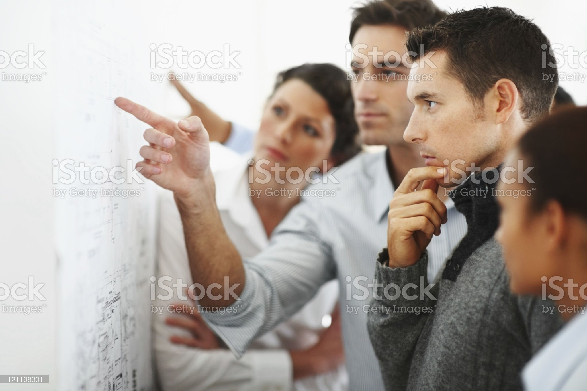 Group of business people looking at a chart royalty-free stock photo