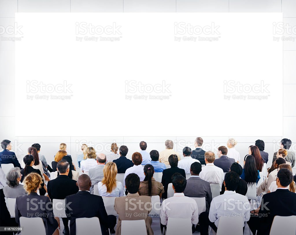 Group of Business People Looking at Blank Presentation stock photo