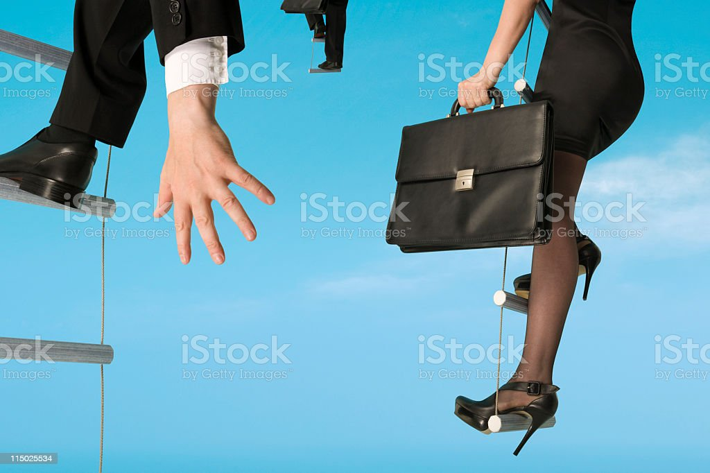 Group of business people moving upwards stock photo
