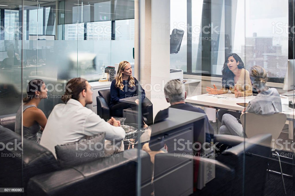 Group of business people on a meeting stock photo