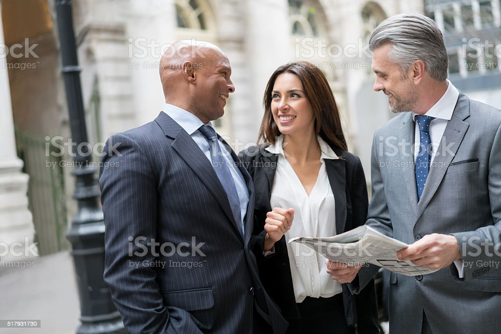 Group of business people reading the news stock photo