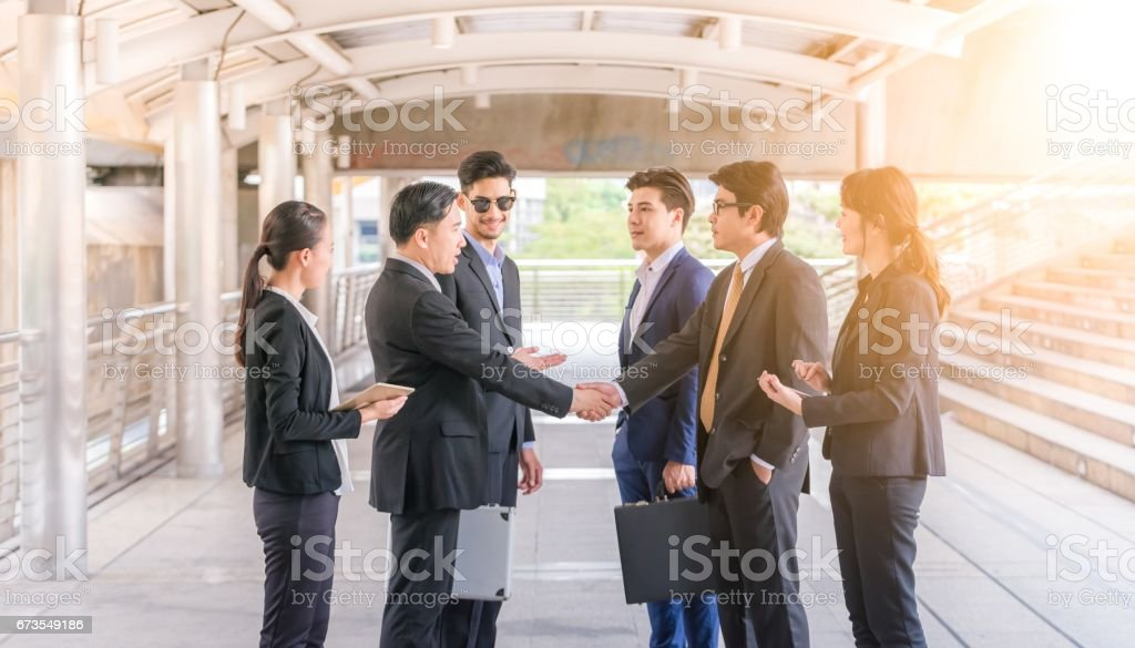 Group of Business people shaking hands,Teamwork finishing up a meeting partners greeting each other after signing contract and go Seminar. stock photo