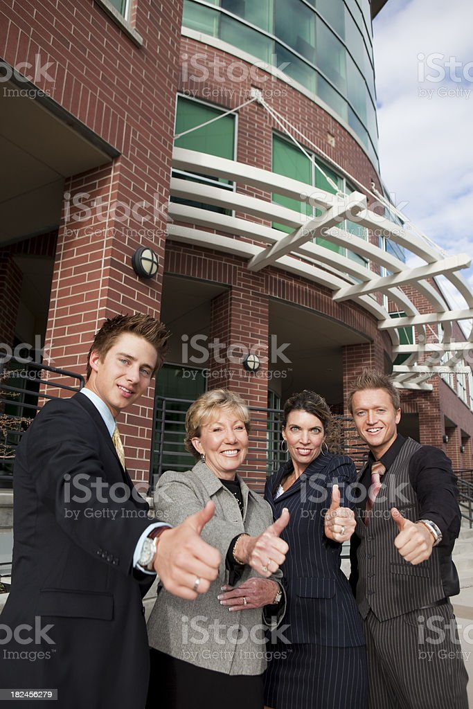 Group of business people showing thumbs-up royalty-free stock photo