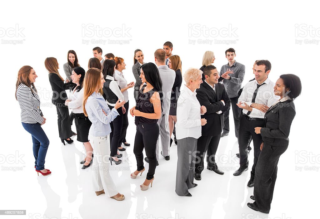 Group of business people standing and talking to each other. stock photo