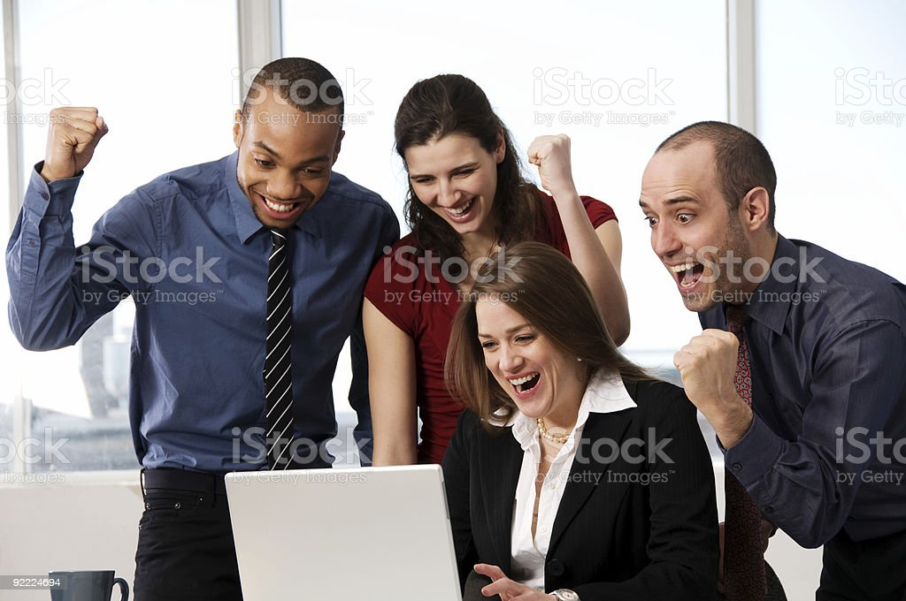 Group of business people standing around laptop royalty-free stock photo