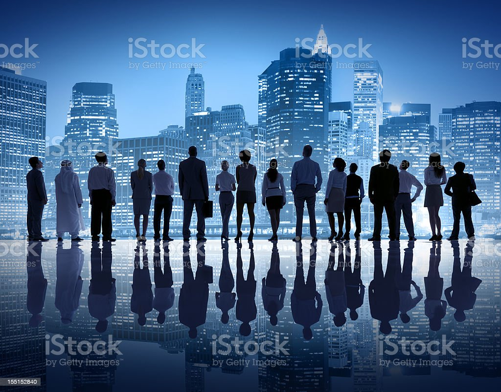 Group of business people starring at city skyline stock photo