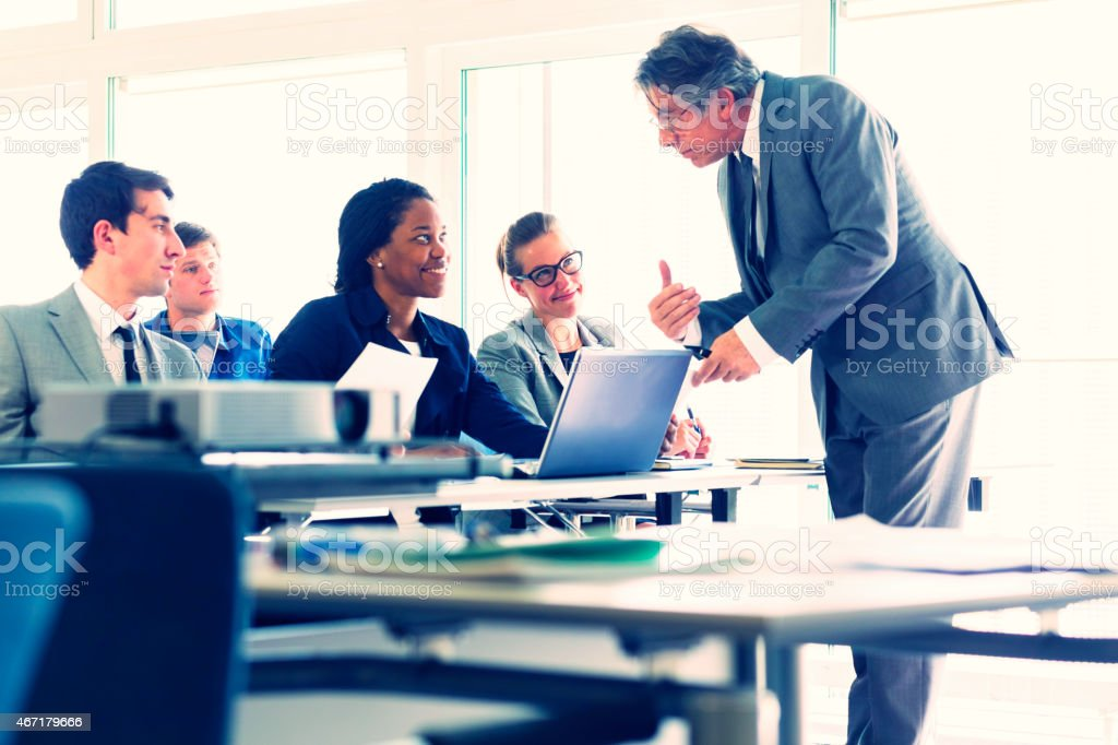 Group of business people, teacher, seminar, classroom stock photo
