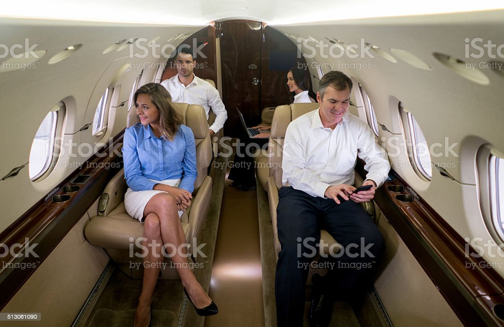 Group of business  people traveling by plane stock photo